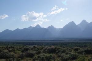 Distant view of mountains taken on car trip.