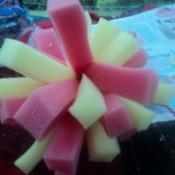 Pink and yellow sponge ball.