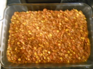 Meat and vegetable mixture in baking pan.