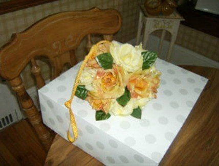 Decorative ball with silk flowers.
