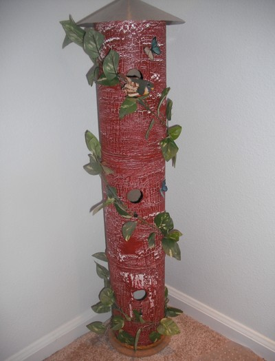 Decorative birdhouse made from oatmeal containers.