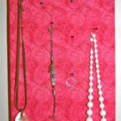 Fabric covered Styrofoam jewelry organizer.