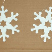 Wooden snowflakes painted white.