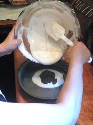 Adding white batter to pan.