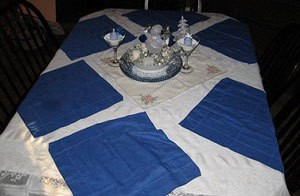 Dining table set with winter decorations.