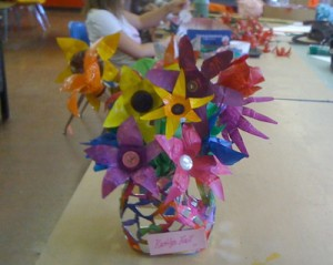 Flowers made from the bottoms of plastic bottles.