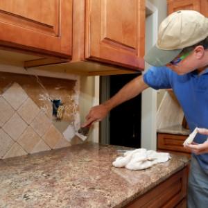 Man Remodeling Kitchen