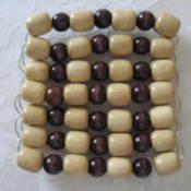 Large bead trivet.