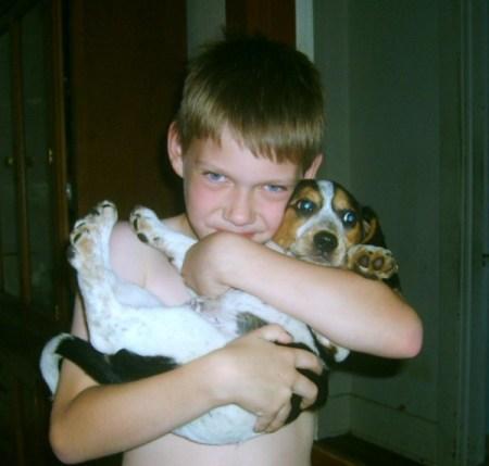 Boy holding a beagle puppy.