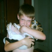 Boy holding a beagle puppy.