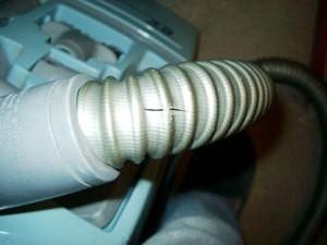 Torn vacuum cleaner hose.