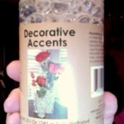 Bottle of Decorative Accents hydrated polymer beads.