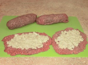 Stuffing spread on steaks.