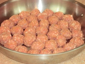 Skillet filled with meatballs.