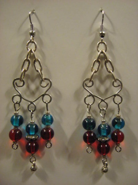 Dangle earrings with red and blue beads.