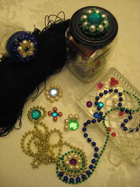 Motif examples, beads, and finished lids.