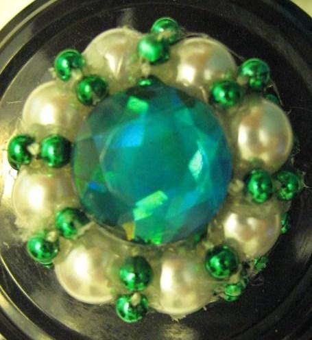 Light blue, pearl, and green bead arrangement.