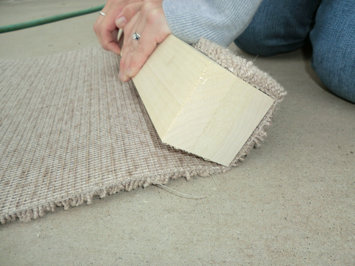 Lay the remaining carpet against the post and using a Sharpie mark it (on both ends) where it overlaps the starting edge of carpet.