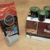 A bag of ground coffee beans and a refillable pod next to a box of Keurig coffee pods.