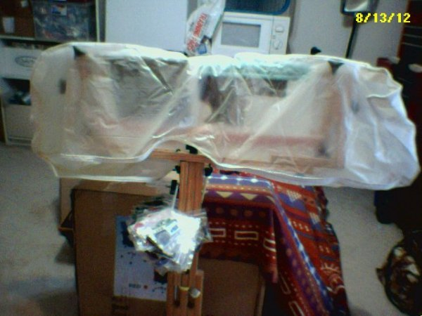 Project wrappen in garment bag.