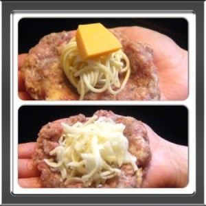Placing spaghetti ball on patty and adding cheese.