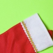 A classic red felt Christmas stocking, ready to be filled.