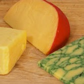 Three different wedges of cheese.