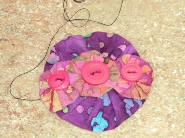 Sewing on last yo yo, step 4.