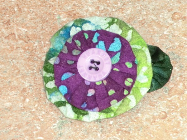 Finished top view of green and purple barrette.