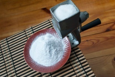 A sugar mill making powdered sugar.