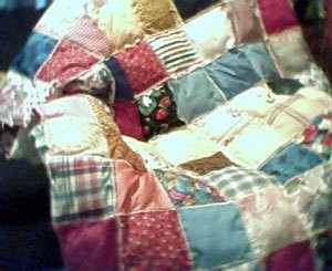 Stuffed square quilt.