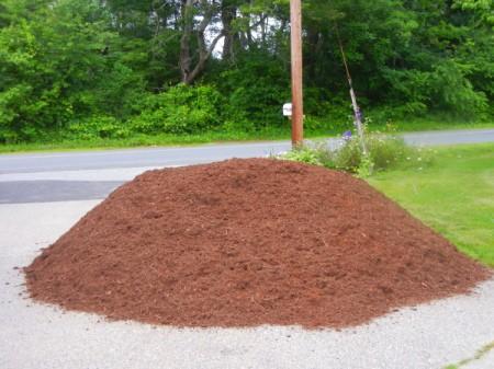 Pile of mulch in driveway.