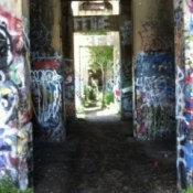 View of receding passageways with lots of graffiti.