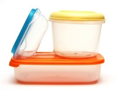 Stack of plastic food storage containers.