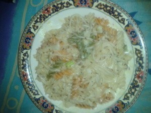 Plate of pasta with cheese sauce.