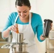 Woman Using a Juicer