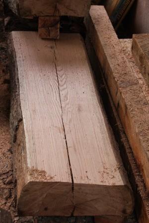 Oak plank with cracks.