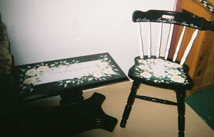 Painted table and chair recycled for use as plant stands.