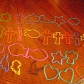 A collection of brightly colored cookie cutters.