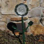 Recycled materials make a garden flower.