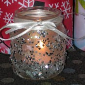 Decorated baby food jar votive candle holder.