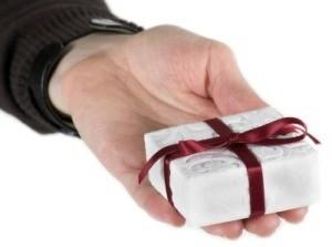 Hand Holding Small Christmas Gift