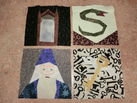 Four quilt blocks including Dumbledore.