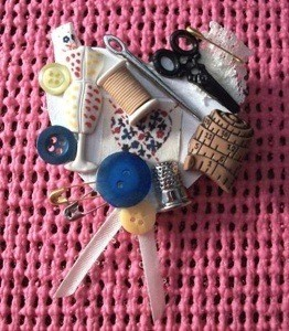 A pin that shows a love of sewing, with lots of buttons and notions displayed.