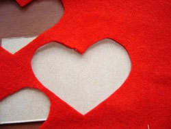 Felt with heart shaped cutout.