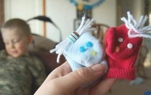Two sock puppets made from baby socks.