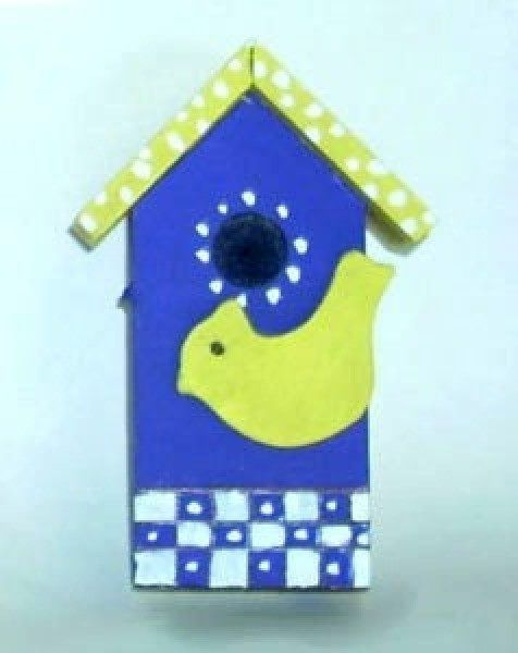 Decorative blue and yellow birdhouse.