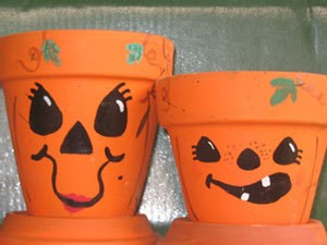Clay pots decorated with Jack-O-Lantern Faces