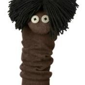 A sock puppet with shaggy yarn hair.