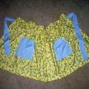 One Yard Apron - yellow floral fabric apron with blue pockets and  ties